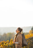 Relaxed young woman in autumn outdoors Stock Photos