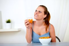 Relaxed young woman eating healthy breakfast Royalty Free Stock Photos