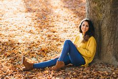 Casual cheerful woman relaxing in autumn royalty free stock photo