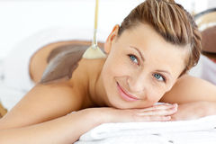 Relaxed young woman enjoying a beauty treatment Stock Image