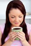 Relaxed young woman enjoying her coffee Stock Photography