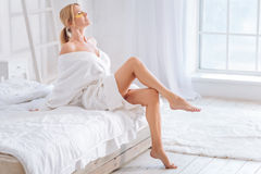 Relaxed young woman enjoying procedure Stock Image