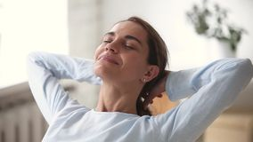 Relaxed young woman with happy face breathing fresh air chilling. Relaxed young woman with happy face eyes closed breathing fresh air chilling with hands behind stock video footage