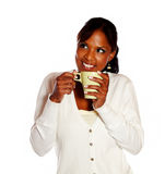 Relaxed young woman having coffee Stock Photos