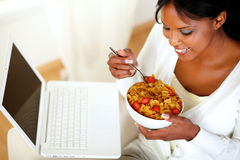 Relaxed young woman having healthy breakfast Stock Photos