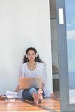 Relaxed young woman at home Stock Photo