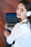 Relaxed young woman at home working on laptop computer Royalty Free Stock Photography