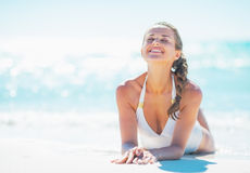 Relaxed young woman laying at seaside Stock Image