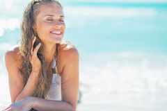Relaxed young woman laying at seaside Stock Photos
