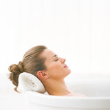 Relaxed young woman laying in bathtub Royalty Free Stock Photos
