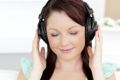Relaxed young woman listen to music Royalty Free Stock Images