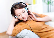 Relaxed young woman listening music Stock Images