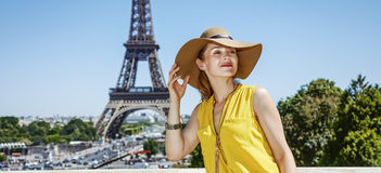 Relaxed young woman looking into distance against Eiffel tower Royalty Free Stock Photography