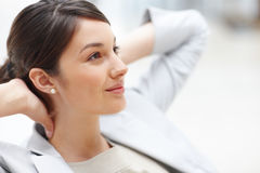 Relaxed young woman lost in deep thought Stock Images