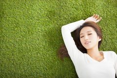 Relaxed young woman  lying on the grass Royalty Free Stock Photos