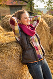 Relaxed young woman near haystack Royalty Free Stock Images