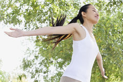 Relaxed Young Woman in Park Stock Image