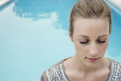 Relaxed Young Woman By Pool Stock Photo