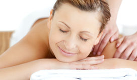 Relaxed young woman receiving a back massage Royalty Free Stock Photos