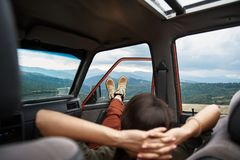 Relaxed young woman resting in the car royalty free stock photo