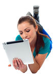 Relaxed young woman surfing on tablet device Royalty Free Stock Photo