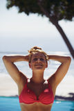 Relaxed young woman in the swimming pool Stock Photos