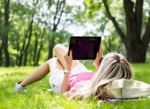Relaxed Young Woman Using Tablet Computer Outdoors Royalty Free Stock Photos