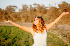 Relaxed young woman walking in the countryside Royalty Free Stock Photography