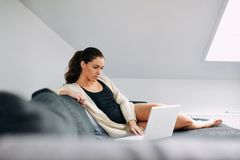 Relaxed young woman working from home Royalty Free Stock Photo