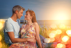 Relaxed younger couple. Travel couple relaxing on the summer lake royalty free stock photo