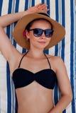 Relaxed youthful woman sunbathing on seashore.  royalty free stock photos