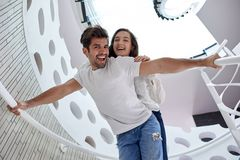 Relaxed yung couple at home  stairs Stock Image