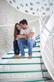 Relaxed yung couple at home  stairs Stock Photos