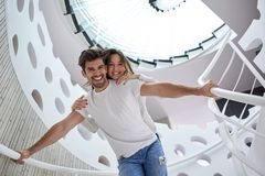 Relaxed yung couple at home  stairs Stock Images