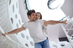 Relaxed yung couple at home  stairs Stock Photo