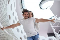 Relaxed yung couple at home  stairs Royalty Free Stock Image