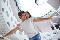Relaxed yung couple at home  stairs Royalty Free Stock Photos
