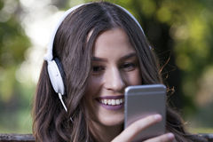 She relaxes listening to music Stock Image