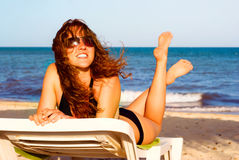 Relaxing. Young beautiful woman is relaxing on the beach Royalty Free Stock Photography