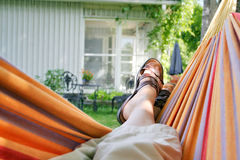 Relaxing. Woman relaxing in a hammock Royalty Free Stock Photo
