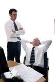 Relaxing. Asian businessman sleeping on the job Stock Photo