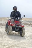 Relaxing. ATV rider relaxing on dirt track Royalty Free Stock Photo