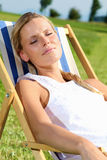 Relaxing. Blond Woman relaxing in the sunshine royalty free stock photos
