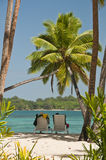 Relaxing in Fiji. Couple relaxing in beach chairs on Yanuca Island, Fiji Stock Photography