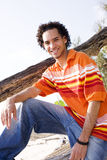 Relaxing. Young Man Relaxing on the Beach royalty free stock image