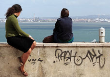 Relaxing. Girls watching the view in Lisbon Royalty Free Stock Photography