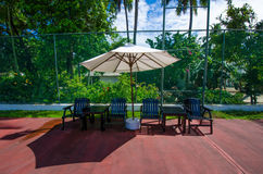 Relaxing area at tennis court Stock Photo