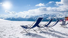Relaxing armchairs and winter landscape Stock Photo