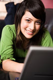 Relaxing asian girl with laptop Stock Photography