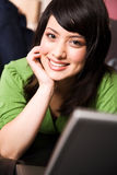 Relaxing asian girl with laptop Royalty Free Stock Photo